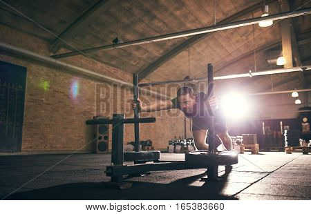 Sportive Muscular Man Doing Push-ups In Gym