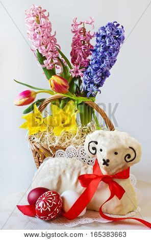Traditional Czech easter decoration - white lamb cake with hyacinth tulips and daffodil and decorated eggs