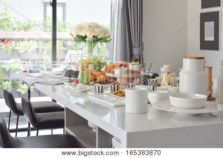 Pastry on the white artificial stone top dining table in the modern dining room