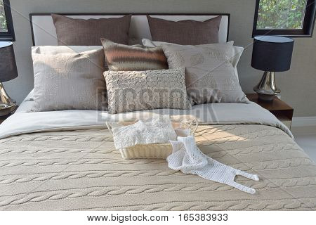 Knitting Basket On Warm Classic Style Bedding With Many Texture Of Pillows