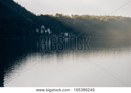Schloss Grub on the shore of Hallstattersee lake by foggy morning Austria