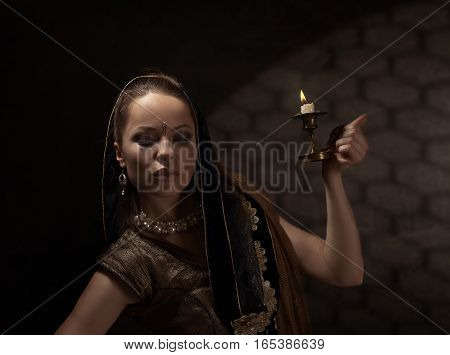 Young Woman With Candlestick In The National Indian Costume