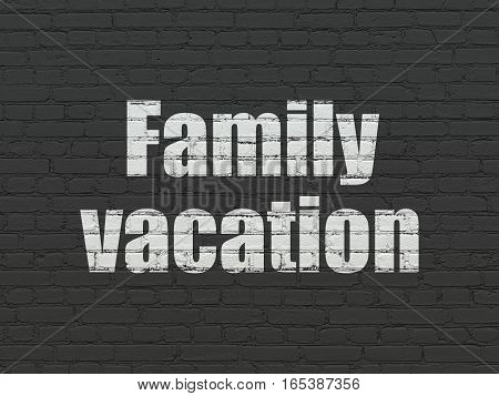 Vacation concept: Painted white text Family Vacation on Black Brick wall background
