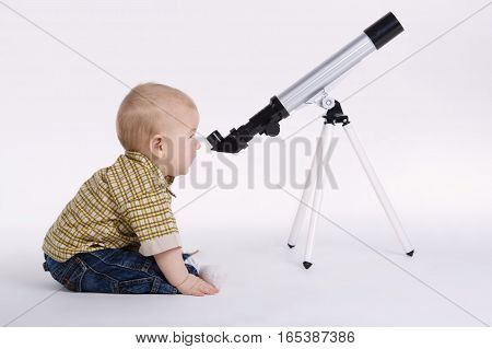cute little boy with telescope exploring stars