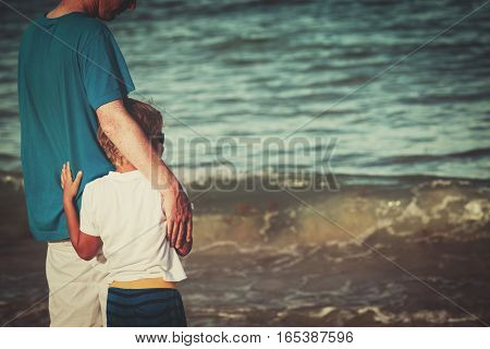 father and little son hug at beach, family at beach