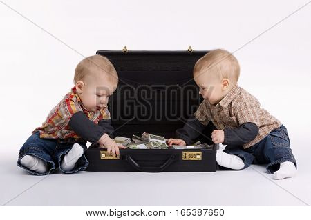 little young bookkeepers with suitcase of money