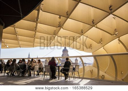 Seville Spain - January 2 2017: people at cafe viewpoint on Metropol Parasol Andalusia Spain. It provides a unique view of the old city center and the cathedral
