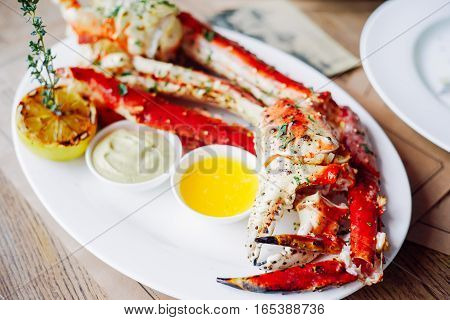 King Crab Cluster with sauces over vintage background