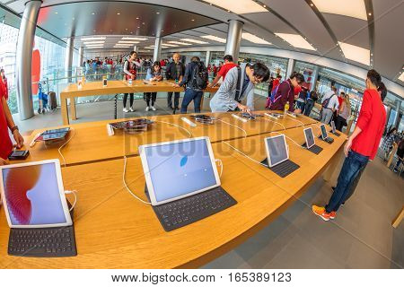 Hong Kong, China - December 4, 2016: close up tablet inside Apple store, IFC Mall, Central District. Apple is world leader in consumer tablets, computers and mobiles. Fish-eye view.