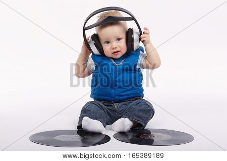 photo of little funny dj on white background