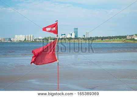 red flag waving on the uruguayan coast