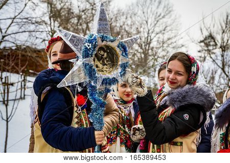 Uzhgorod Ukraine - January 15 2017: Female folklore collective performs during the seventh ethnic festival Christmas Carols in the old village. During the festival visitors can familiarize with a variety of Christmas customs caroling and celebrations edge