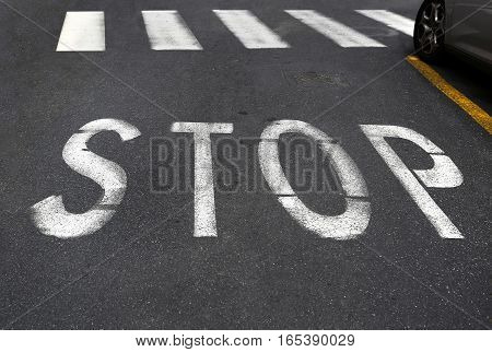 City crosswalk with symbol stop closeup road texture background
