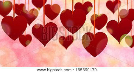 Valentine's day upper decoration with hanging hearts on defocused background.