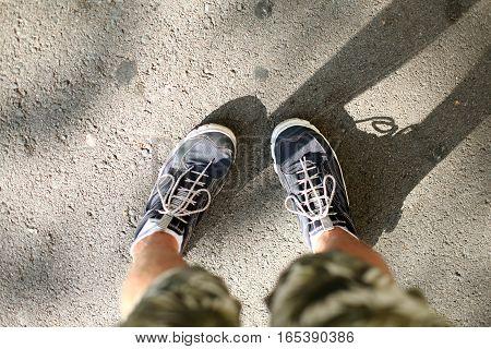 Men's feet in sneakers. Spain, Barcelona city
