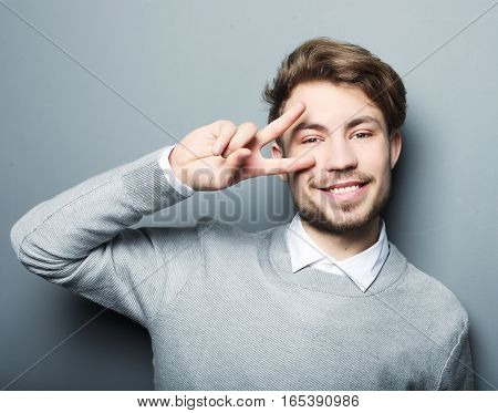 Young  bearded man wearing casual posing in studio