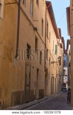Ancient bystreet in Florence Tuscany Italy Sunny day