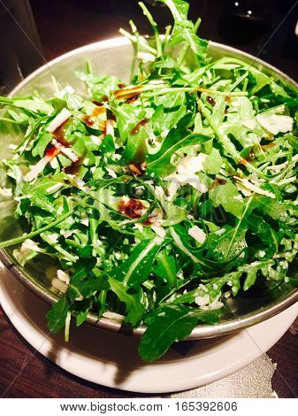 Rocket salad with parmesan cheese and balsamic vinegar