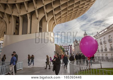 Seville Spain - January 2 2017: pink balloon and people walking under Metropol Parasol Andalusia Spain