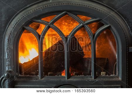 Closeup Of Burning Fire Wood In Home Fireplace.