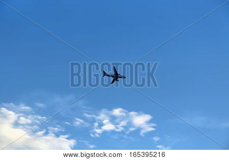 Airplane in the blue sky with white clouds