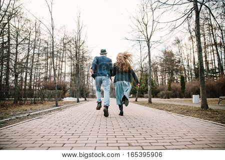 Guy and girl run away on the road