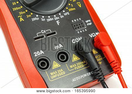 Digital multimeter with attached probes closeup on white background