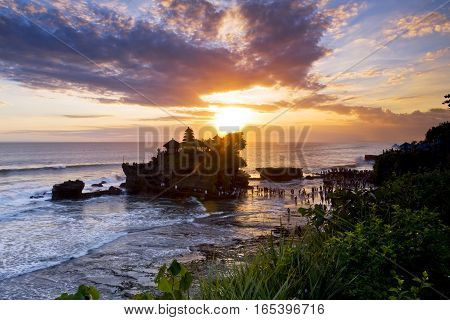 Tanah Lot temple, one of Bali's most famous landmarks, during a beautiful sunset. Bali, Indonesia.