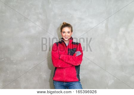 Proud Craftswoman In Front Of Rendered Wall