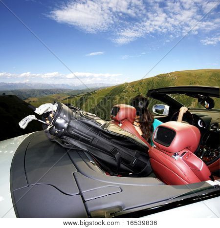 A golfer in the sports car outside