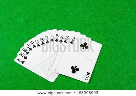 Full suit of cards on a card table
