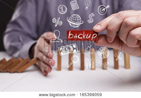 Business, Technology, Internet And Network Concept. Young Businessman Shows The Word: Backup