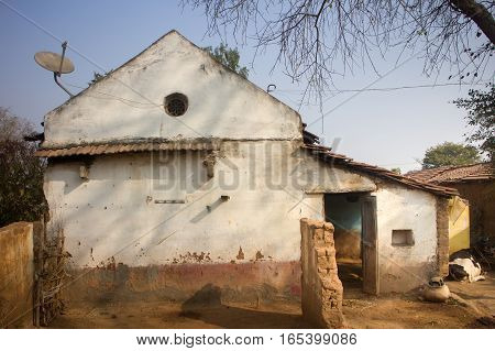 Poor Indian household (farm)  . House poor crumbling in yard. Andhra Pradesh Anantapur