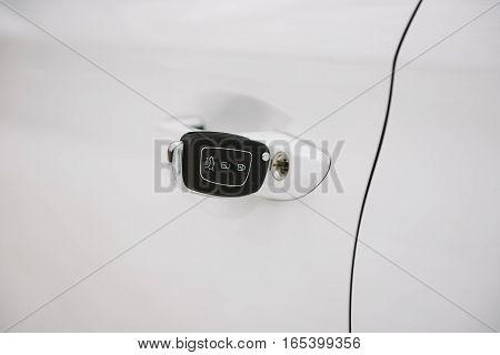 Car keys in white door lock closeup with copy space. Opening car door with key