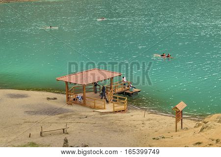QUILOTOA, ECUADOR, FEBRAURY - 2016 - Aerial view of people at shore of Quilotoa lake Latacunga Ecuador