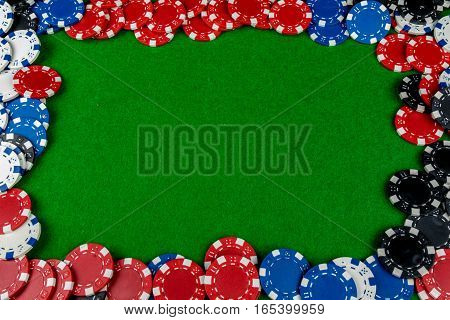 Betting chips forming a frame on a card table
