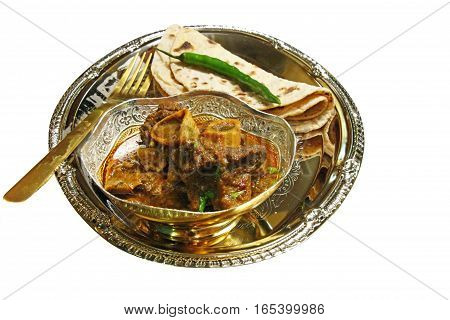 A platter with a bowl of mutton curry with chapati on white background