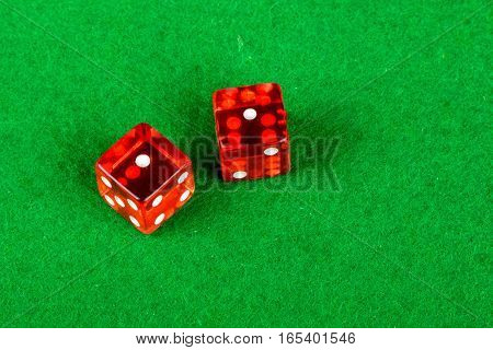 Gambling dice on a card table showing double 1