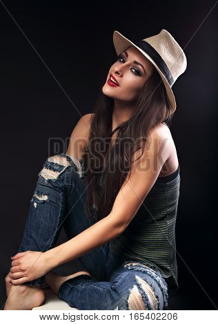 Beautiful Happy Female Model With Long Brown Hair Posing In Cowboy Hat And Fashion Blue Rippred Jean
