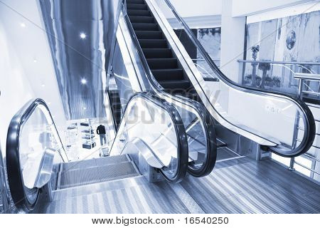 the escalator of a subway station. poster