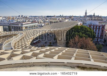 Seville Spain - January 2 2017: Views from footbridge over Metropol Parasol building Seville Spain. It provides a unique view of the old city center and the cathedral
