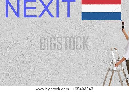 a woman paint dutch elections (nexit) on a wall