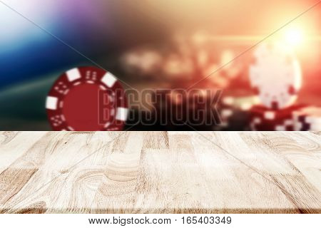 Empty Wooden Tabletop Over Poker Chips On The Table In Casino Vintage Background For Product Montage