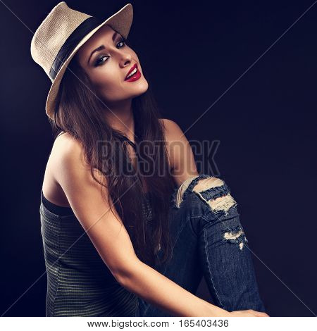 Beautiful Happy Female Model With Long Brown Hair Posing In Cowboy Hat And Fashion Blue Ripped Jeans