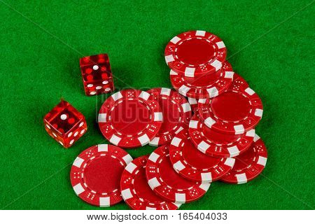 Gambling dice and betting chips on a card table