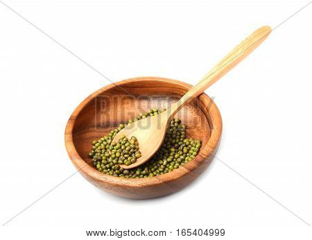 Mung bean in a wooden bowl with a spoon.Isolated on a white background.