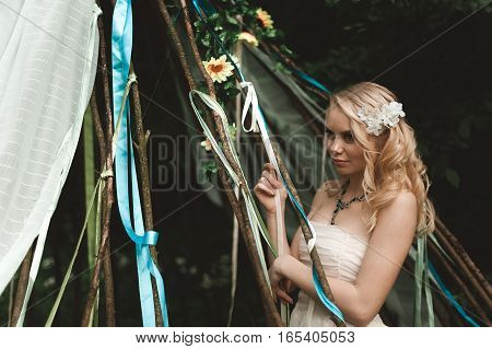 Beautiful Young Woman With Long Curly Blonde Hair Dressed In Boh