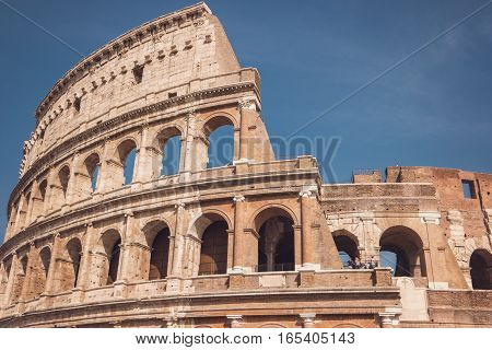 Colosseum on sky background. Arches and walls. Beauty of the old world.