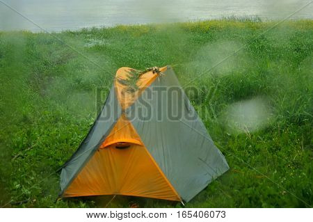 Rainy rainy day. Comfort in warmth of tent