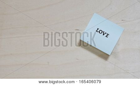 Sticker On A Wooden Plywood, Words On A Paper Sticker